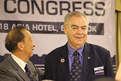 Bernie Beston is congratulated on his election to FIP PResident by Mr Tey